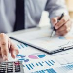 Business_man_or_accountant_working_Financial_investment_on_calculator_with_calculate_Analyze_business_and_market_growth_on_financial_document_data_graph_and_writing_,Accounting,Economic,commercial.