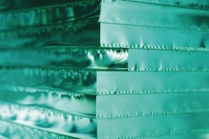 Glass_texture._Abstract__background_with_stack_of_glass_sheets._luminous_texture._side_corner_view