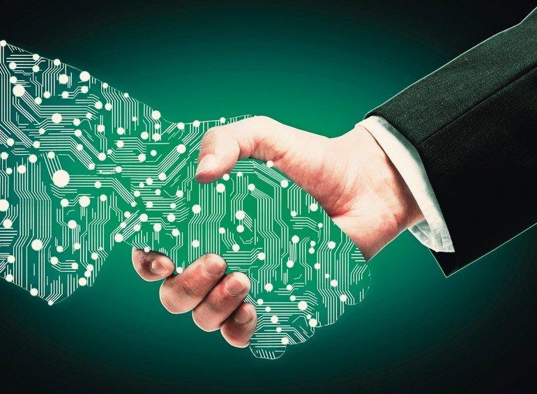 Businessman_shaking_digital_partners_hand_on_green_background