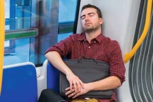 Tired_commuter_sleeping_on_the_metro_seat