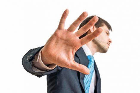 Politician_is_showing_hand._No_comment_gesture._Isolated_on_white_background.