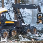 modern_forestry_machine_in_a_winter_forest