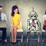 Cartoon_robot_sitting_in_line_with_applicants_for_a_job_interview_