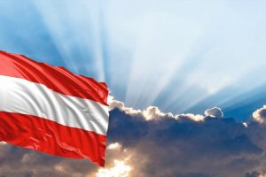 Austria_waving_flag_on_blue_sky._3d_illustration