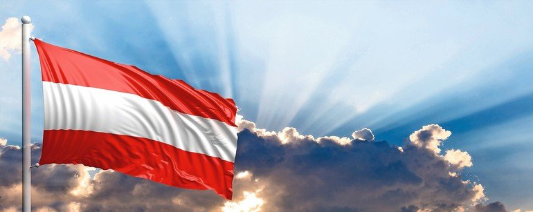 Austria_waving_flag_on_blue_sky._3d_illustration
