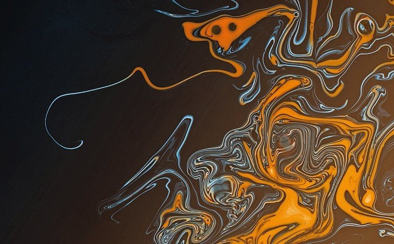 Swirling_paint_oil_abstracts_of_water_and_acrylic_paint_creating_a_hazardous_pollution_theme_for_environment_and_nature_themes_and_ideas._Globes_release_into_the_orange_black_liquid