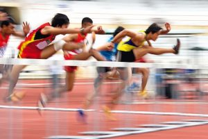 Image_of_men's_110_meters_hurdles_action_with_intentional_blurring_to_portray_speed.