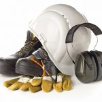 Work_safety_and_protection_equipment_-_protective_shoes,_safety_glasses,_gloves_and_hearing_protection_over_white_background