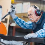 senior_man_operating_machine_in_the_factory