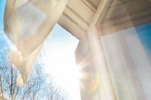Window_is_open_wind_blows_curtain_sun_shining_through_window_blue_sky_background