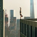 Man_performs_a_handstand_on_the_edge_of_a_skyscraper