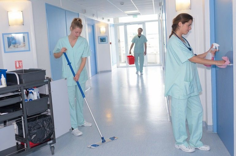 cleaner_with_mop_and_uniform_cleaning_hospitals_corridor