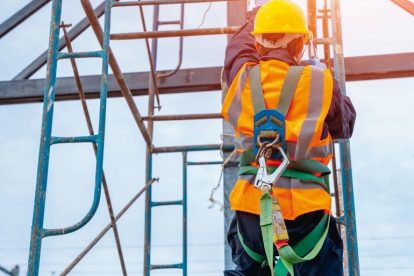 Construction_worker_wearing_safety_harness_belt_during_working_at_high_place.