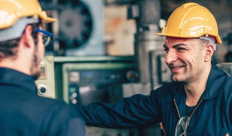 happy_worker,_smiling_industrial_technician_engineer_enjoy_working_together_with_coworker.