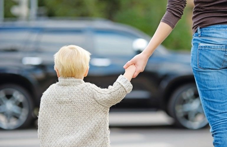 Mother_and_toddler_son_crossing_the_street_on_the_crosswalk_close_up