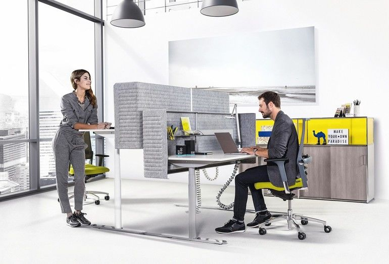 Meeting_room_for_six,_blank_poster_on_wall,_lamps_above._Panoramic_window,_city_view._Loft._Concept_of_meeting._3D_rendering