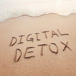 digital_detox_concept,_words_written_on_the_sand_of_beach