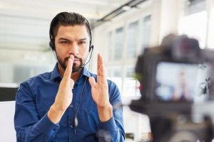 Business_man_as_coach_or_consultant_recording_video_for_an_online_seminar