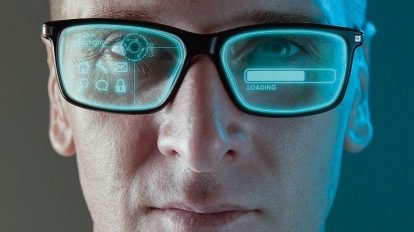 A_close_up_image_of_a_man_wearing_smart_arugmented_reality_glasses_with_virtual_screen_displaying_icons_and_loading_screen_-_modern_technology_concept_image_with_copy_space_for_text.