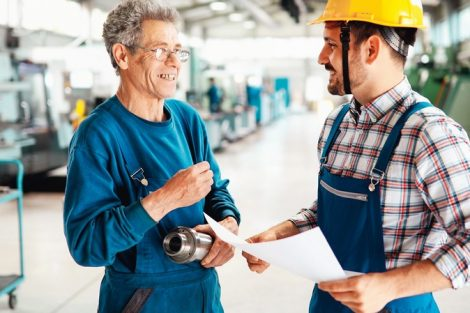 Team_Of_Engineers_Having_Discussion_In_Metal_Industries_Factory