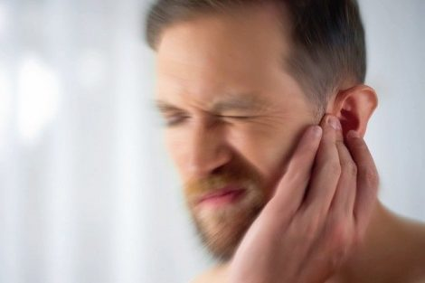 Man_feels_pain_in_middle_ear,_meningitis_and_hearing_loss,_inflammation,_closeup