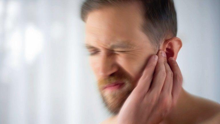 Man_feels_pain_in_middle_ear,_meningitis_and_hearing_loss,_inflammation,_closeup