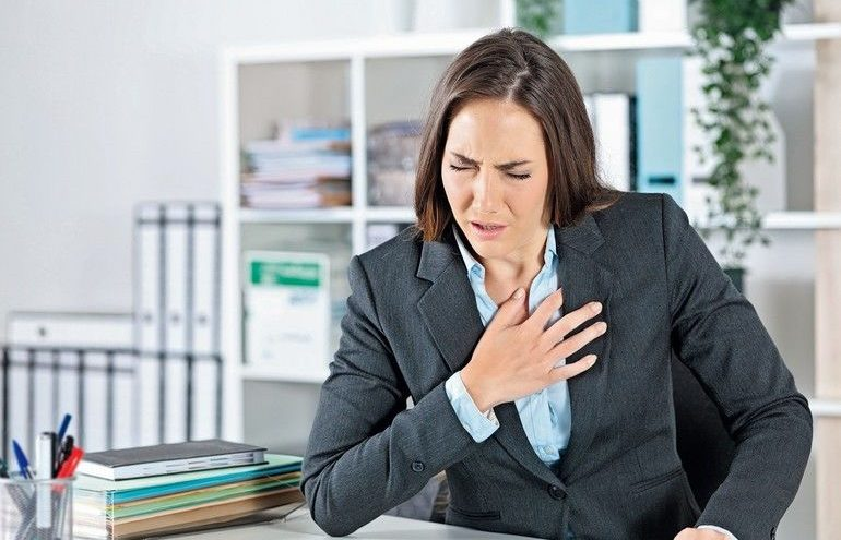 Sick_executive_suffocating_holding_chest_at_office