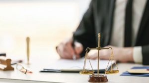 Scales_of_justice_at_workplace_of_notary_public