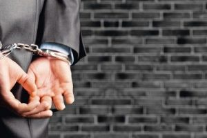 Cropped_image_of_male_hands_in_handcuffs