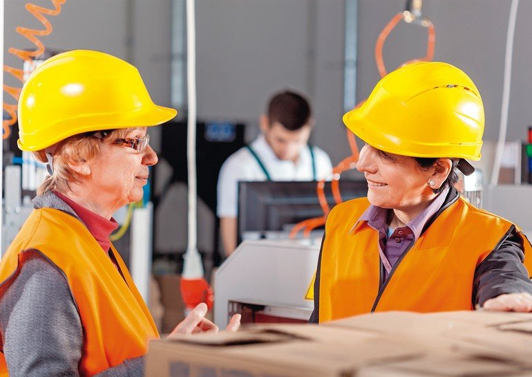 Female_employees_discussing_at_production_area,_horizontal