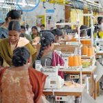 Female_workers_at_their_sewing_machines._