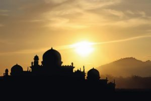 A_silhouette_of_a_mosque_sunset_background
