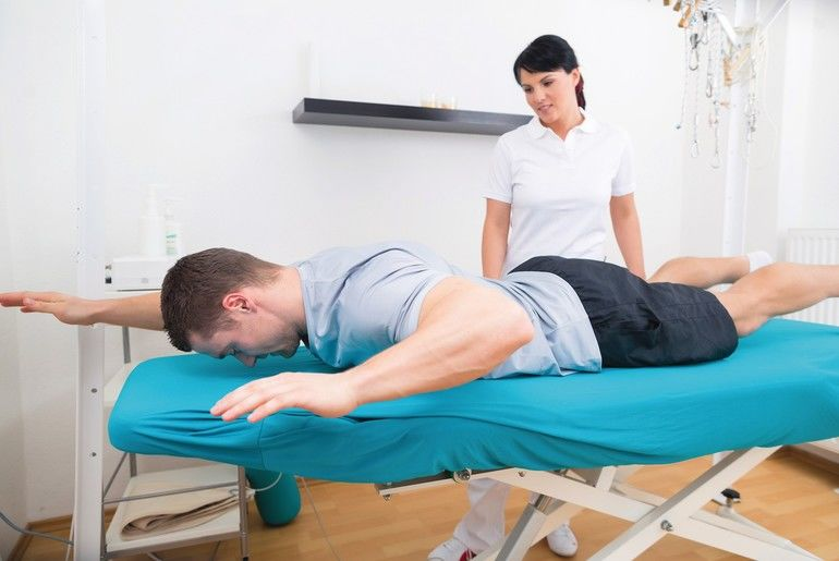 Patient_at_the_physiotherapy_doing_physical_exercises_with_his_therapist