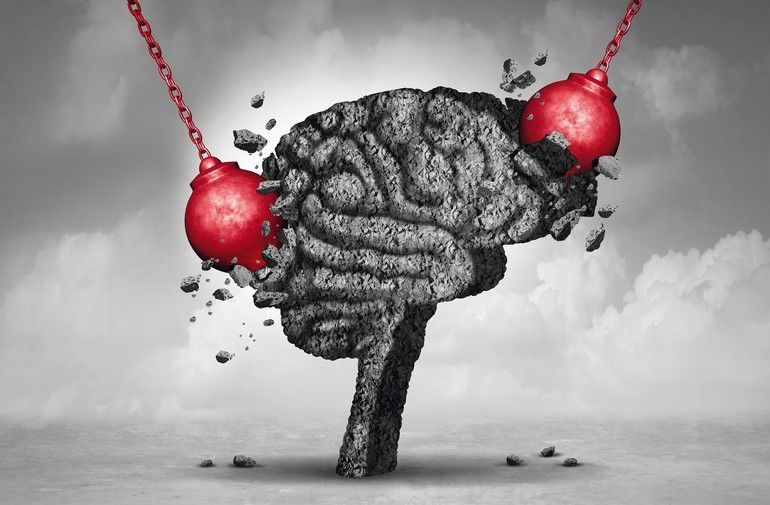 Headache_pain_and_pounding_painful_migraine_concept_as_a_human_head_brain_made_of_cement_being_destroyed_or_renovated_by_a_group_of_wrecking_ball_objects_as_a_symbol_for_personal_change_as_a_3D_illustration.