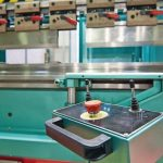 Industrial_hydraulic_press_with_power_button