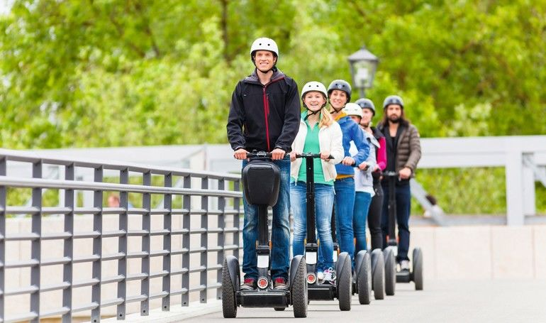 Tourist_group_having_guided_Segway_city_tour_in_Germany