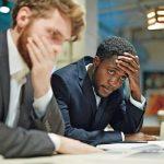 Stressed_businessmen_looking_at_laptop_display
