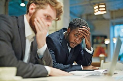 Stressed_businessmen_looking_at_laptop_display