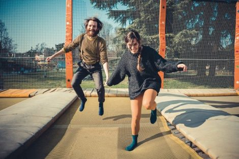 young_modern_stylish_couple_urban_city_jumping_trampoline_outdoors