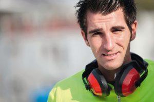 Man_wearing_ear_defenders